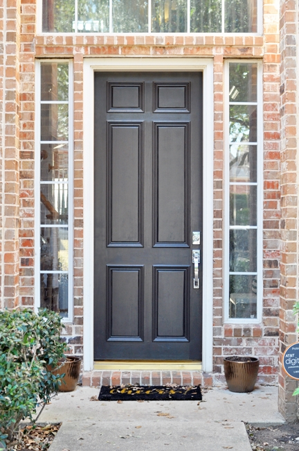 Black front door with chrome handleset