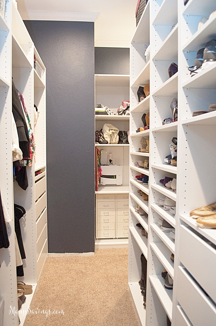 IKEA Pax closet system built in to be a custom closet solution in a walk in master closet.