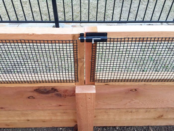 How I built my custom diy raised vegetable garden bed complete with bunny gates.