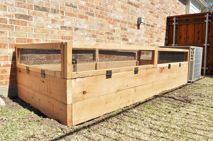 The completed DIY Custom 9x4 raised garden bed with bunny gates.