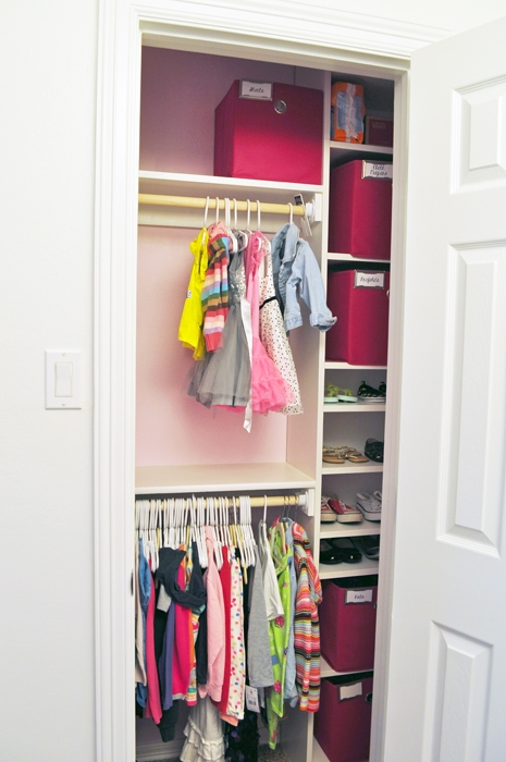 See how I rebuilt the small closet in our girl's shared room using an IKEA Bookcase in order to maximize the space for two growing girls.