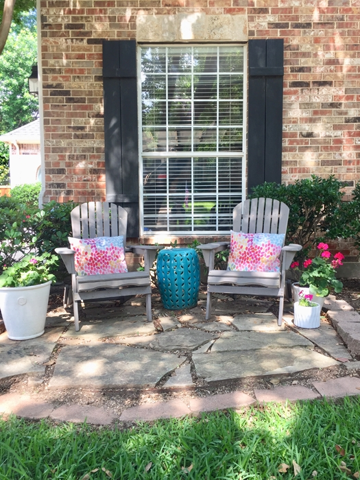 See how we updated our front yard with a small patio all on a budget!