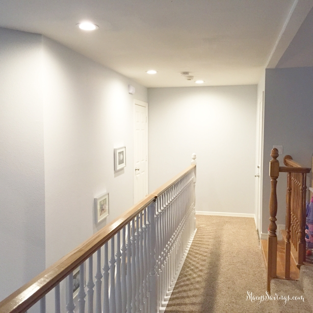 We replaced some old faceted hanging light fixtures over our stairs with clean recessed cans and led bulbs. Bright light with no headaches!