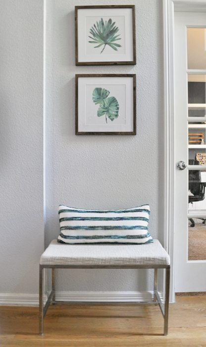 A small bench in my entryway is the perfect place to remove shoes or wait for your ride. Framed palm prints from Target finish the space.