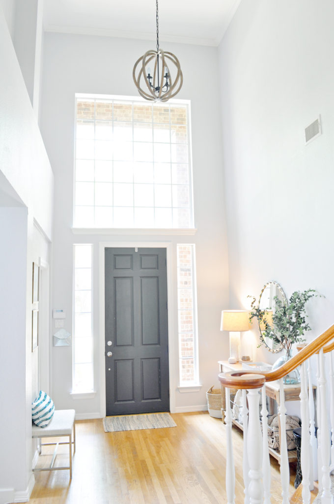See how we updated our entryway on a budget with paint and a few key furniture pieces!