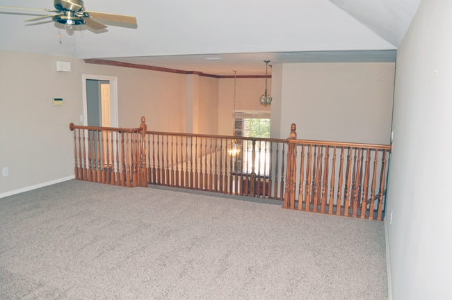 A Before shot of our 16x16' playroom upstairs.