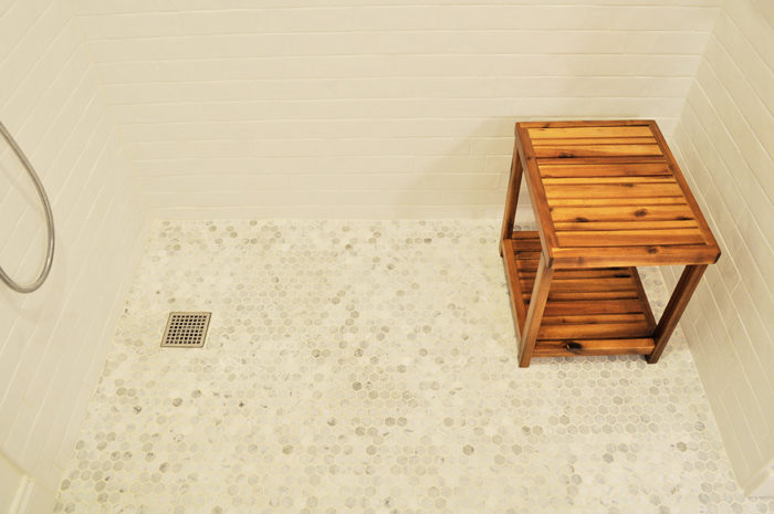 See how we achieved a curbless shower on a slab foundation for our Disability-Friendly Guest Bathroom Remodel!