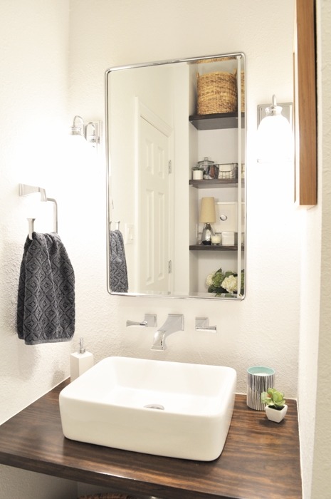 Disability Designed Guest Bathroom Remodel. DIY Floating Vanity is wheelchair friendly. Medicine Cabinet for storage. Modern Farmhouse vibe.