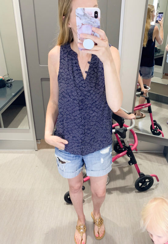 See what I tried on and purchased in my Mini Target Haul for June 2019! This navy button up sleeveless blouse is perfect for work or with jeans!
