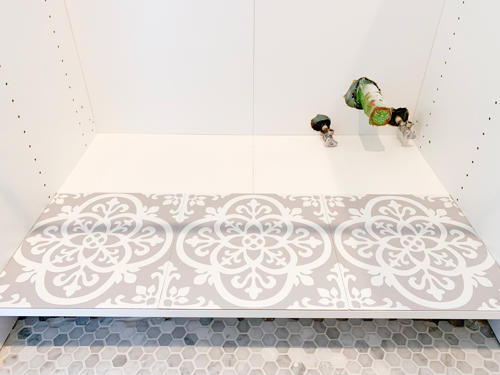 How I Used Pretty Peel Stick Tile To Protect My Sink Cabinets