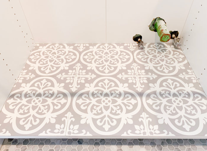 I used easy to install Peel & Stick vinyl tiles in a farmhouse pattern to make my kitchen sink cabinet pretty and protected! See how you can do it too!